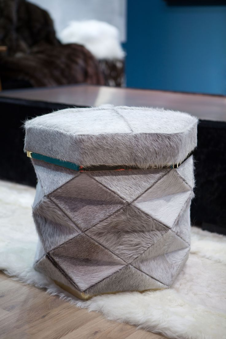 stool cowhide - stool cow - stool leather- stool design - stool fur - hotel stool - luxury stool Both confortable and stylish with an Eastern origami inspiration, this stool will carry you to a magic world. Each piece is customizable to your wishes – shaved lambskin, sheepskin, cowhide, leather, fabric or fur - Pouf en peau - pouf design - pouf montagne - pouf chalet - pouf cuir - pouf tissus - pouf décoration - pouf haut de gamme - pouf original - pouf hôtel - pouf chambre -
